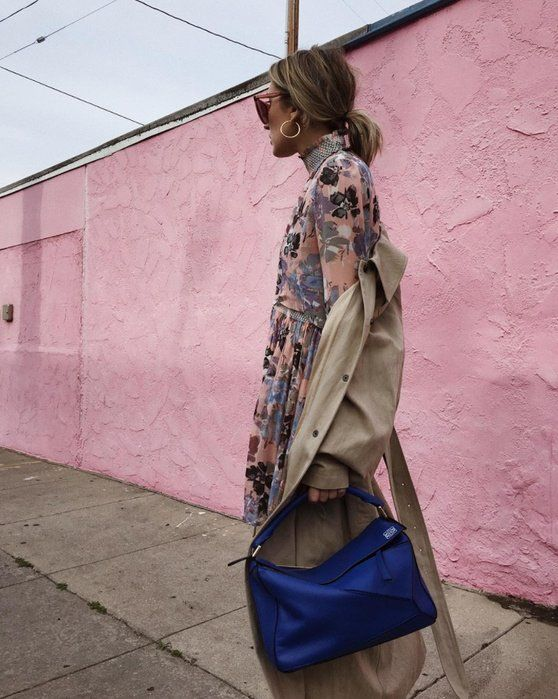 For work, style your floral dress with a trenchcoat, patent ankle boots, and a statement bag.