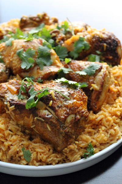 CURRIED CHICKEN WITH COCONUT RICE~ 1 whole chicken cut into 10 pieces, 4 tsp sweet curry powder, ½ tsp cayenne pepper, ½ tsp kosher salt, 2 tbsp olive oil, 3 cloves garlic minced, 3 tbsp fresh ginger minced, 1 yellow onion diced, 2 tbsp tomato paste, 2 cups basmati rice, 1 can unsweetened lite coconut milk, fresh cilantro.