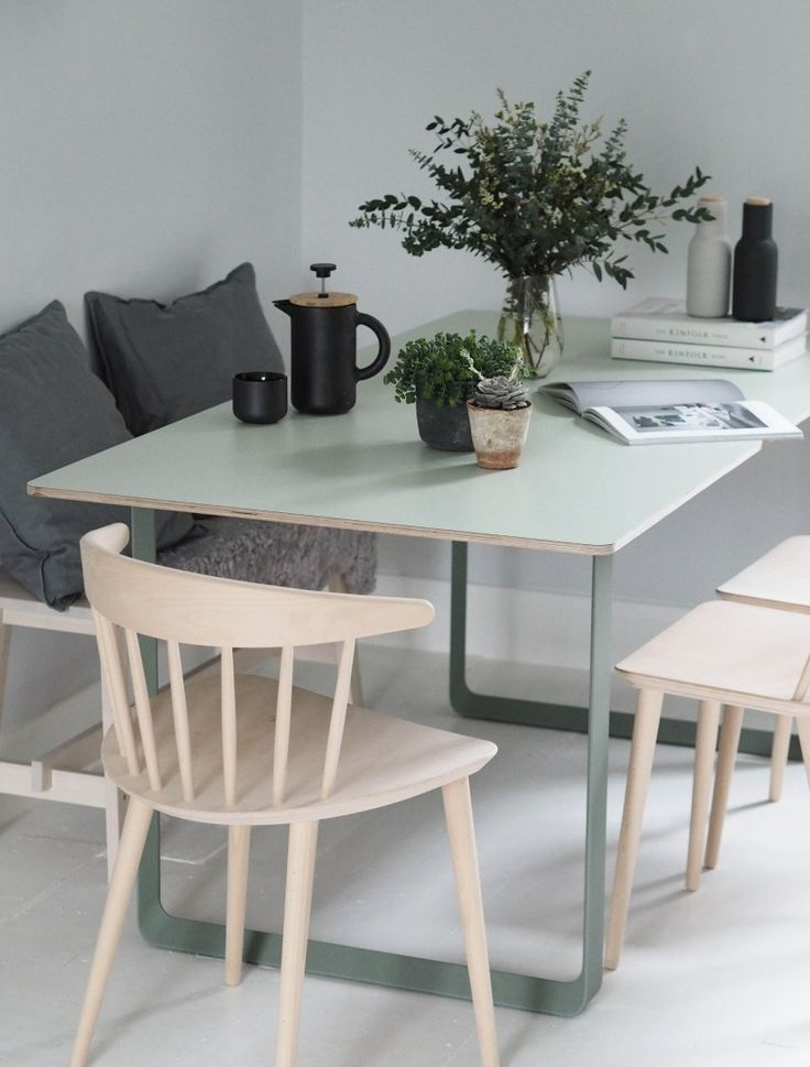 soft green dining table - Muuto 70/70 table in green - modern Scandinavian design dining table - plants in the home