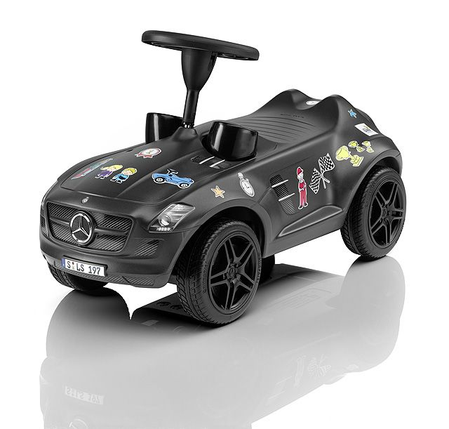 "SLS AMG, Bobby-Benz, TRIBUTE TO BAMBI 2014 B66961250 Available in AMG Monza grey magno, the fourth-generation Bobby-Benz is a limited-edition charity product, specially produced for the ""TRIBUTE TO BAMBI"" Foundation to raise money for disadvantaged children. Top-quality features of this children's car include infinitely adjustable, precision double-pivot steering, Whisper Wheels with profiled tyres and authentic-look AMG rims with black hub caps."