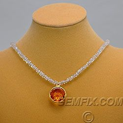 """Deep golden-amber colored citrine in Andrew Gulij's trademark """"Stellar-Cut"""" measures 20 ½ mm. in diameter. Citrine is gorgeous and glowy. Set in a 14KT yellow gold bezel, it hangs on a 19 inch strand of sparkling faceted quartz with hook and eye closure. Price: $995 Gemfix"""