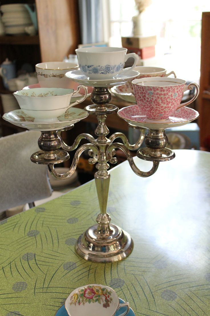 teacups on candelabra - I often see candelabras in charity shops as well as old crockery. Plan ahead and delegate. Put florists oasis in tea-cups and fill with flowers