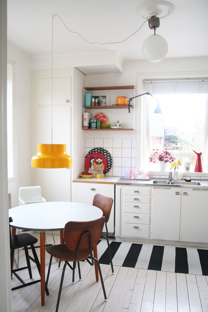 50's kitchen by the window and a yellow Bumling lamp
