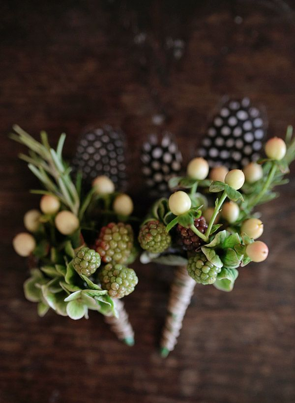 Buttonholes with feathers and berries