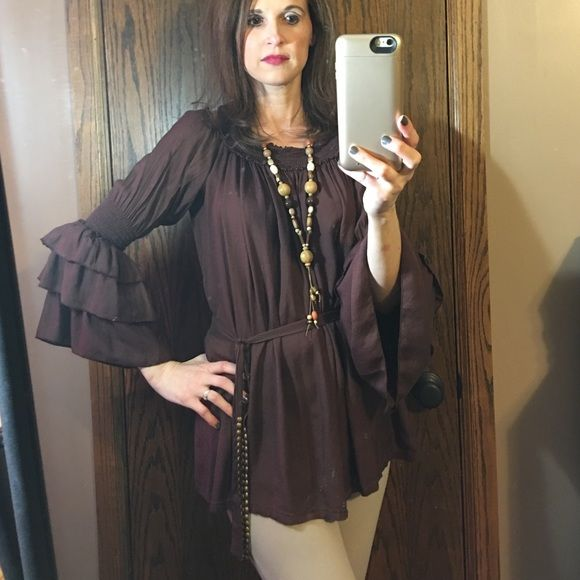 NWOT brown boho ruffle shirt. Brown ruffle shirt can be worn on or off shoulder. With or without belt (belt not attached). Very flowy. 100% Viscose. Very soft. Hand wash. Worn only once. (I tend to lean more towards bright colors) . Tops Blouses