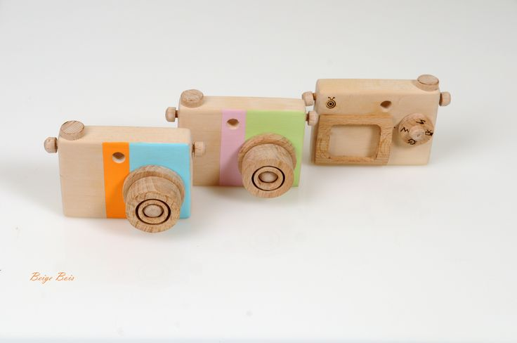 Peek through the viewfinder, rotate the setting dial to change the camera's mode, turn the two rotating lens to focus and finally take a picture. Children can put their own photograph or cut pictures from magazines to display on the wooden screen frame at the back of the camera.