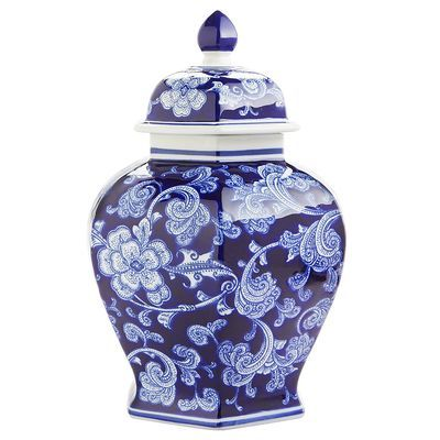 "Inspired by 14th century Chinese ""general jars"" used to carry salt, spices, rice and ashes, our decorative ceramic temple jar delivers a mighty dose of artistry. Hand-painted botanic patterns in cool shades of cobalt cover this <i>objet d'art</i> from foot to lid, resulting in a striking conversation piece that can stand alone or mingle with other jars of varying sizes."