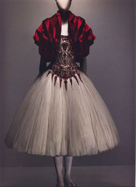 """Alexander McQueen Autumn/Winter 2008-09    Ensemble, The Girl Who Lived in the Tree  Dress of ivory silk tulle embroidered with red glass crystals; bolero of red silk    Photographed by Sølve Sundsbø for Alexander McQueen: Savage Beauty    """"[In this collection] she was a feral creature living in the tree. When she decided to descend to earth, she was transformed into a princess."""""""