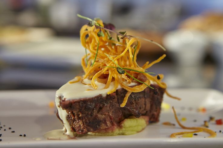 Grilled Beef - served with mashed green pea potatoes, truffle sauce and caramelized onions