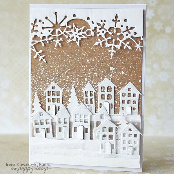 handmade winter card ... die cut houses and snowflake border ... kraft base splattered with white for snowfall ... luv it ... poppystamps ...