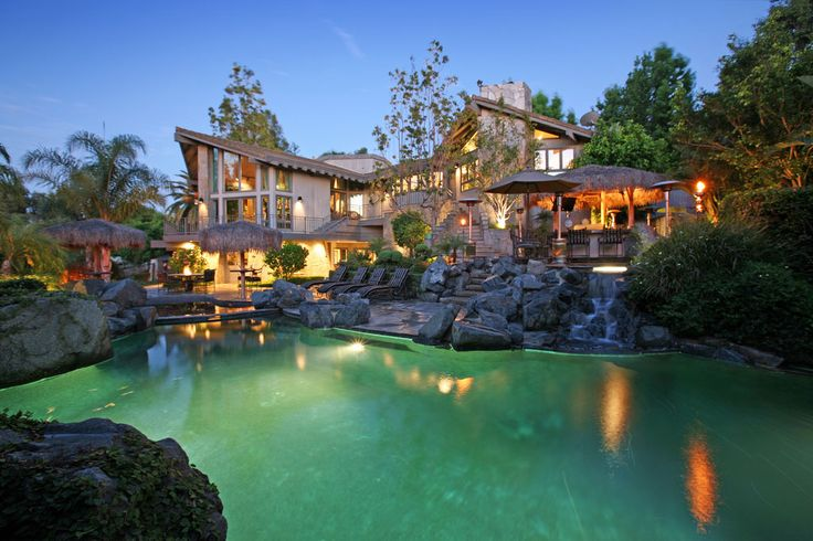 Luxury home in Anaheim Hills, California with a secluded resort theme complete with a rock lagoon pool, exotic plants, air conditioned indoor basketball court with a 1,400 bottle wine cellar.