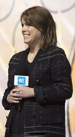 Princess Eugenie looked in high spirits, who opted for a stylish checked coat with black jeans for star-studded charity event at Wembley Arena in London.