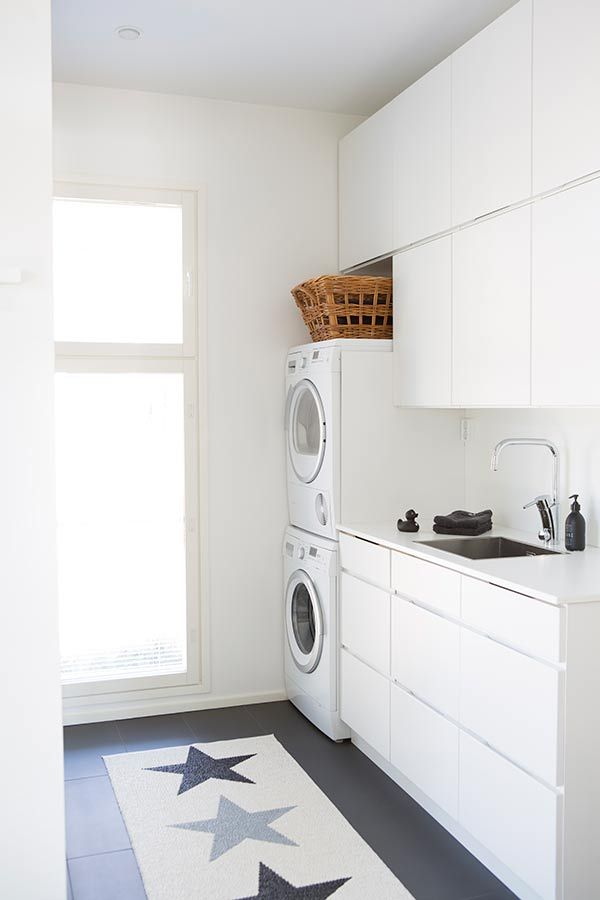 Laundry inspiration, all white cabinetry with dark floors - Found on Pinterest