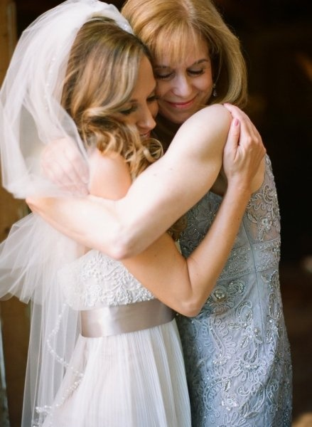 ADORE this picture of the bride and her mom.