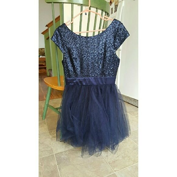 "Midnight Blue Prom Dress Size 9 midnight blue prom dress, only worn once. In very good condition! Skirt is very fluffy. It hits above the knee on me and I am 5'2"". Will gladly consider offers! Dresses Midi"