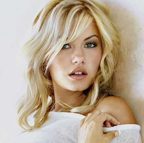 Elisha Cuthbert Hairstyles with Layered Bangs