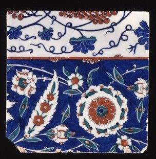 Iznik Tile, 16th century. Vine scroll after early Ming porcelain prototypes, undulating flower foliate scroll with composite lotus + saz leaves. Made of red (bole), cobalt painted and glazed and bevelled ceramic, pottery.