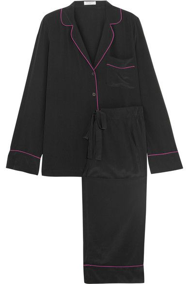 Equipment's 'Avery' pajamas are cut from washed-silk - we love how the magenta piping pops against the classic black. The lightweight shirt has a relaxed cut and the wide-leg pants have a flexible drawstring waistband for an adjustable fit. This set comes in a matching pouch so you can pack it neatly into your drawers or carry-on luggage.