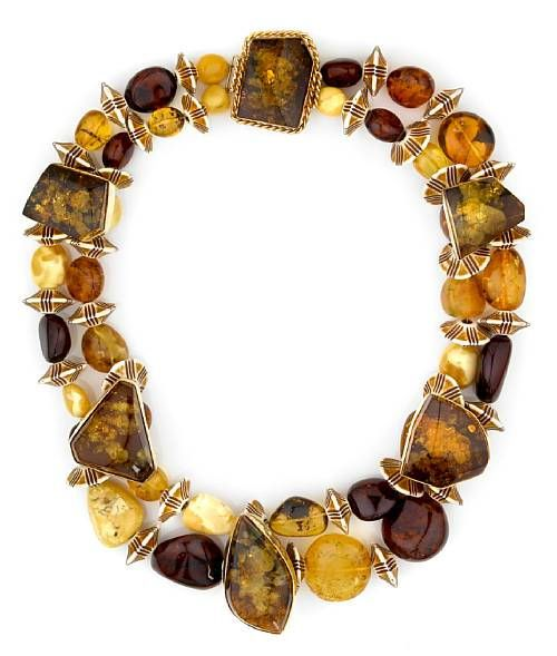 Tony Duquette (American, 1914-1999), 1990s. An amber, bone and vermeil necklace, signed Tony Duquette, with original box, length 26 1/2in. Sold for $ 3.660