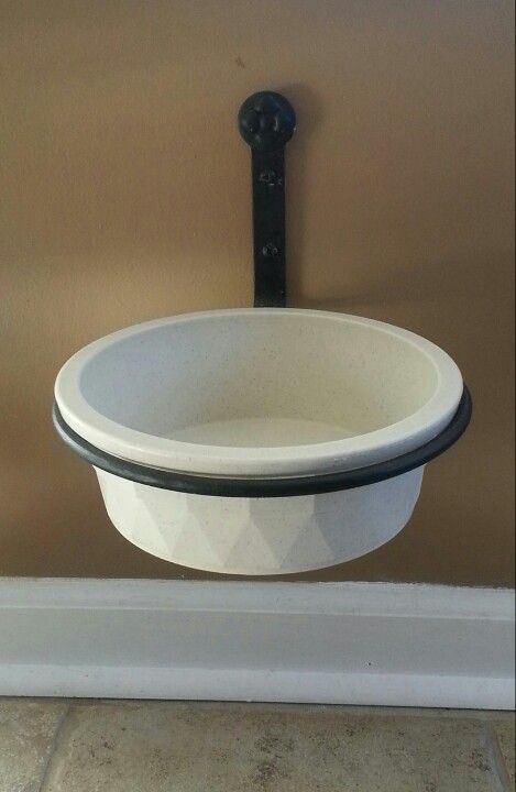 Great hack for an elevated dog bowl - wrought iron plant holder and a pet crock. Works great.