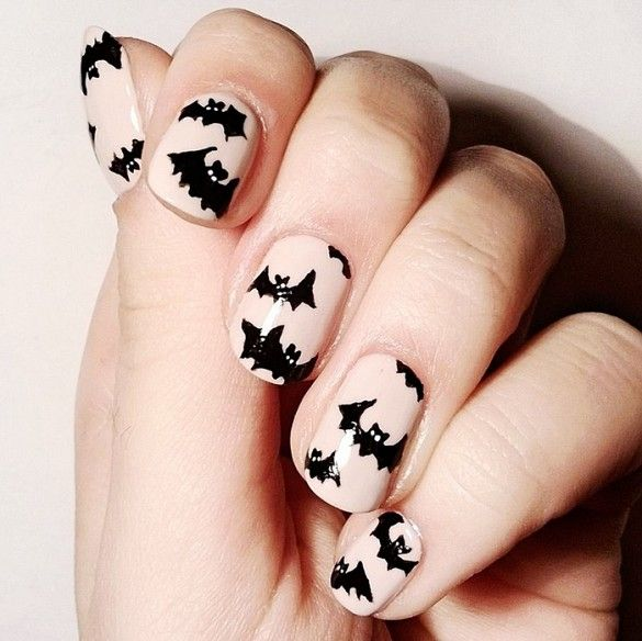 An opaque nude polish makes the bat design of this manicure look super chic. // #nailart #halloween