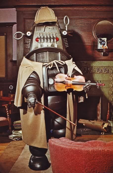 While awaiting SHERLOCK, let's revisit the unsold 1966 pilot where Sherlock Holmes is played by...Robby the Robot! The premise: Moriarty's descendant, evil but bumbling inventor Paul Lynde, finds a brain in the Prof's ice box. He transplants it in Robby, who becomes... SHERLOCKABOT! Amusingly, Holmes (voiced by Basil Rathbone himself!) is happy as a robot, & delights in annoying Lynde, who plays Moriarty as... Paul Lynde. It's a funny pilot, & considering the crap on TV at the time... why…