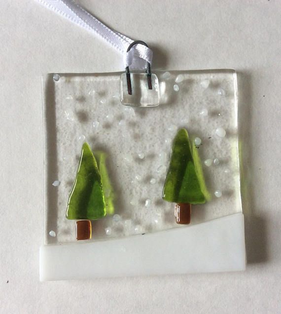 These fused glass Christmas tree decorations have been handmade by myself in my small home studio. Each Decoration measures 5 cm square and has white ribbon for easy hanging. They have a picture of two Trees in the falling snow, these look lovely hung on trees or equally pretty hung in a window where they can catch the light. These make lovely gifts and will come bubble wrapped and boxed. Please look in my shop for more fused glass.