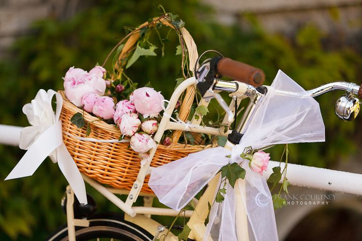 Bicycle with flowers in the front basket