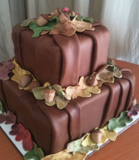 Wedding Cakes : Mary's Cakes & Pastries Northport Alabama    Folded Chocolate Grooms Cake   Two double layer square tiers covered in folded chocolate fondant with fondant details.