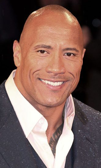 """Bio: Dwayne Johnson (born Dwayne Douglas Johnson in Hayward, California on May 2, 1972) is an American actor and wrestler for WWE. Also known as """"The Rock"""" from his wrestling career, he…"""