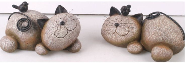 Image from http://www.openwindowdesigns.com/Resin%20Rock%20Cat%20with%20Bird%20-%2040-P2457.jpg.