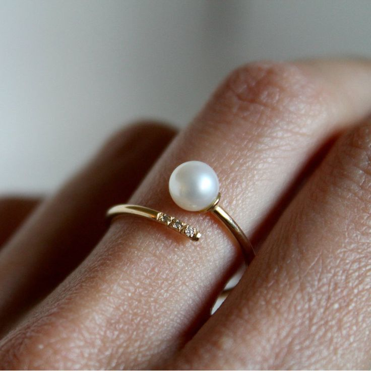 Visibly Interesting: Stunning minimalist 14K Yellow Gold Pearl cuff ring by Lumo. Features one 5.5mm Pearl on one end with 3 1mm White Diamonds adorning the other