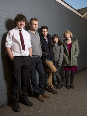 Outnumbered. Image shows from L to R: Ben (Daniel Roche), Pete (Hugh Dennis), Jake (Tyger Drew-Honey), Karen (Ramona Marquez), Sue (Claire Skinner). Image credit: Hat Trick Productions.