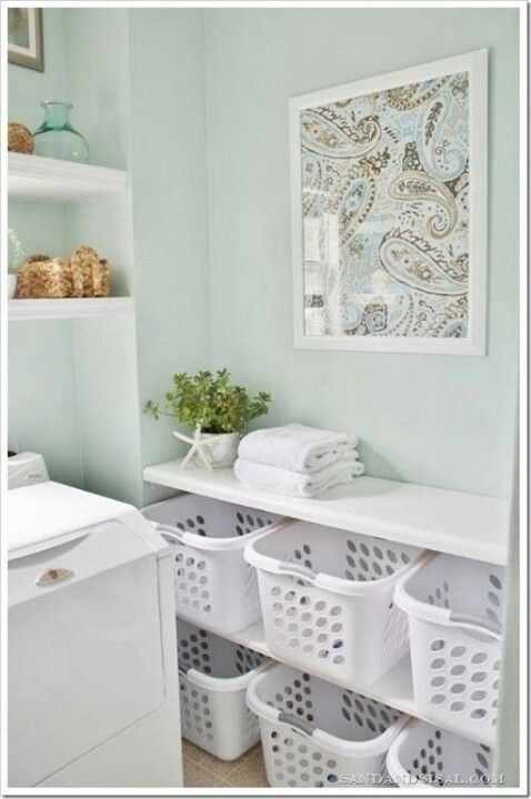 Want baskets on shelves like this. One basket per person plus one for towels and one for unmatched socks. by Olive Oyl