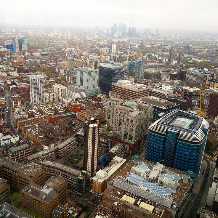 London panorama with Canary Wharf in the background as seen from the 40th floor of The Heron Tower.