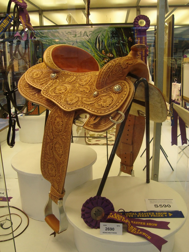 (Standard Of Excellence cabinet at the Sydney Royal Easter Show)Handmade, Fully carved western pleasure saddle by Aussie Saddlemaker Renee Matthews.  It won 1st Prize and Royal Agricultural Society of NSW Award for Best Australian Equine Related Exhibit (Standard Of Excellence) at the Sydney Royal Easter Show 2012. Visit  www.matthewssaddlery.com.au   'LIKE' Matthews Saddlery on FACEBOOK.  You can contact Renee at matthewssaddlery@hotmail.com