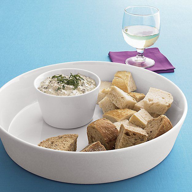 Simple, versatile design serves chips and shrimp, crackers and party mixes, canapés and finger foods. White porcelain coordinates with most dinnerware and table appointments.