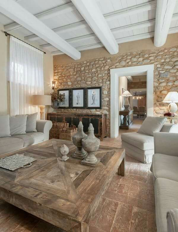 Wooden beams, exposed rocks, rustic floors and loads of neutrals. Mediterranean chic!