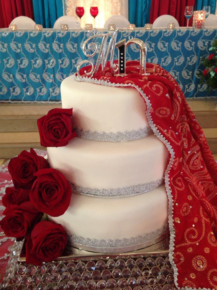 "Three tier wedding cake: chocolate raspberry & lemon raspberry. 12"",10"", 8"""