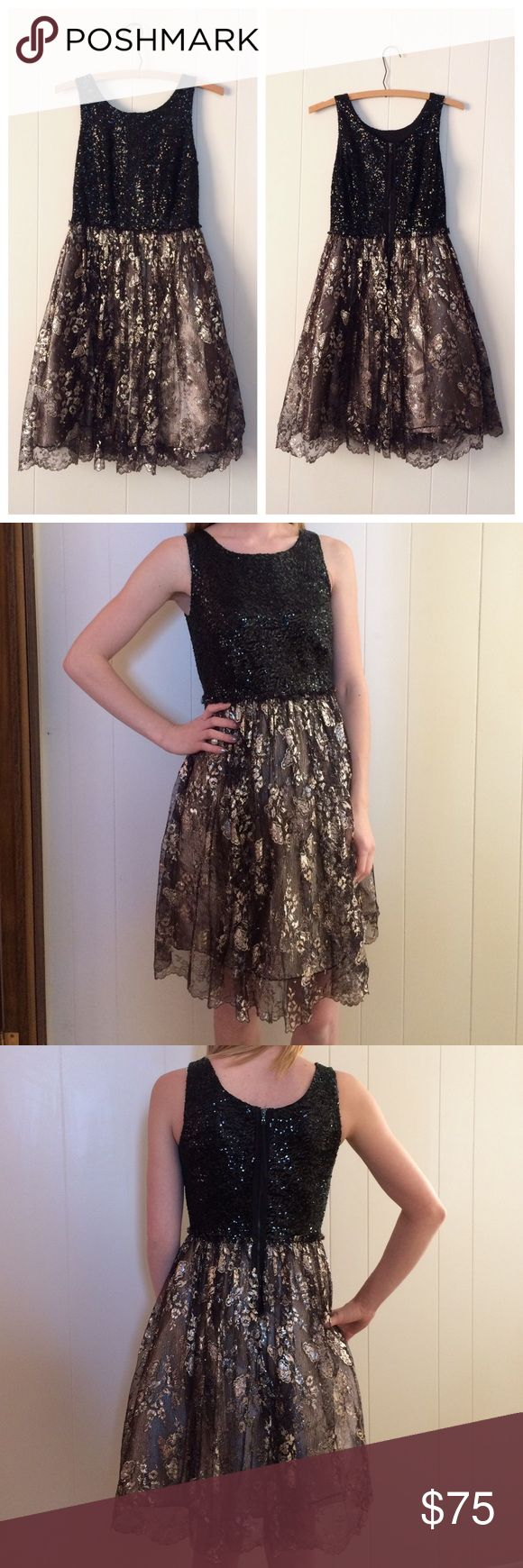 Anthropologie Leifsdottir Black & Gold Dress Anthropologie Leifsdottir black & gold metallic dress. Black sequin top & the bottom has gold underneath a tulle floral black & gold layer. Zips up the back. Preloved and has a spot underneath the tool in the gold fabric where the stitching came undone & could easily be sewn back together & is not noticeable when wearing, picture in collage above. Size 0. If you have any questions please ask before buying. *Colors may vary slightly from pictures…