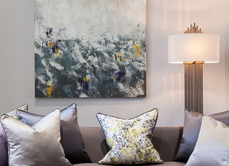 detail styling of drawing room grey sofa with bespoke made art and cushions designed by www