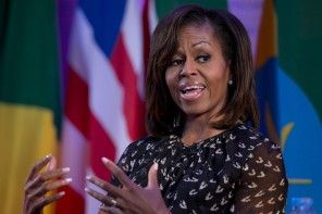 A District police officer accused of threatening Michelle Obama has been cleared of administrative charges related to the first lady but was found guilty of posting a derogatory job description on social media and depicting the president as a communist, his attorney said Monday.