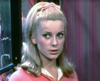 deneuve's hairdo from the first part of Umbrellas of Cherbourg (when she gets older and fancier she wears an insane updo).