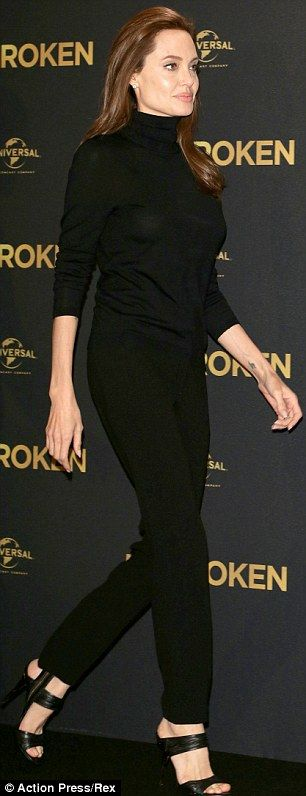 Angelina Jolie steps out in conservative black outfit at photocall for new movie Unbroken   Daily Mail Online