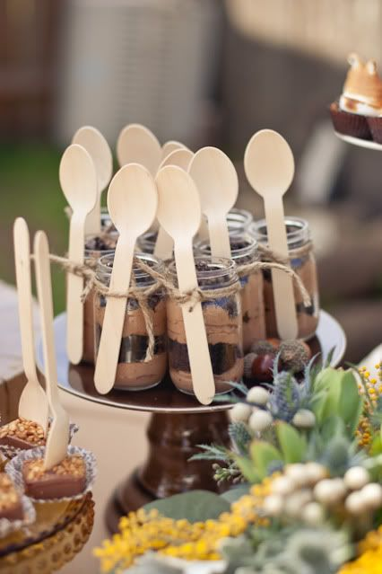 Desserts in small mason jars complete with twine or ribbon and a spoon. Nice way to make day before party.