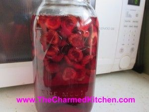 Cherry Vanilla Liqueur  2 c. granulated sugar 4 c. vodka or brandy 1 lb. large, washed, stemmed and pitted sweet cherries 2 (6-7 inch) vanilla beans, broken into several pieces  Place sugar and vodka or brandy in a large jar- I used a half gallon canning jar. Stir until sugar is mostly dissolved. Add cherries and vanilla and cover jar. Do not stir. Place in a cool, dark place for 3 months, without stirring or shaking. Strain and filter. Makes 4-6 cups.