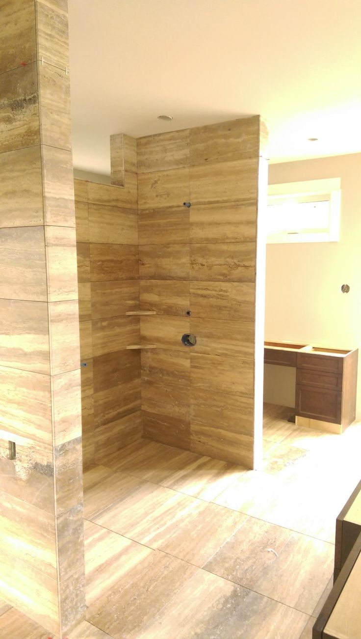 Vein cut Travertine bathroom with Level entry shower and linear drain