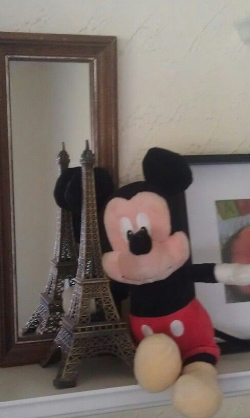 On a shelf w the Eiffel Tower