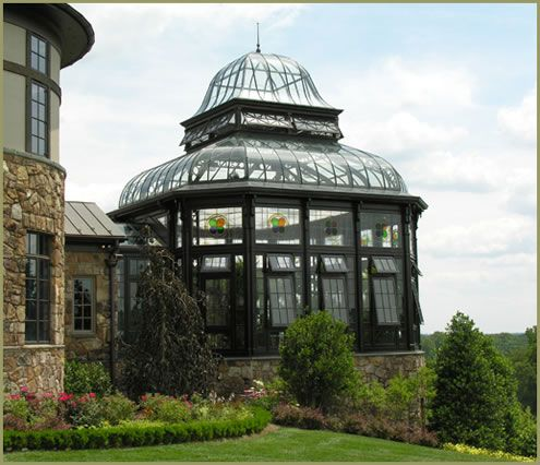 Tanglewood Conservatory. This recently constructed Antique greenhouse was inspired by the great conservatories and greenhouses of yesteryear. Designed to house twenty- foot tall trees, the decoratively forged steel structure and curving rooflines hearken back to that imaginative era.