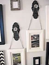 Love the idea of using old door knobs to hang pictures from! One or two accompanied by other frames or mirrors adds a nice mix.
